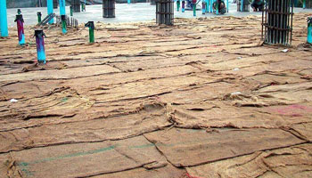 Wet coverings method of curing concrete