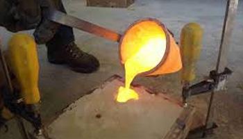 Casting metal on silica sand