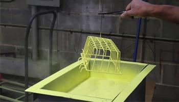 Electrostatic fluidised bed coating