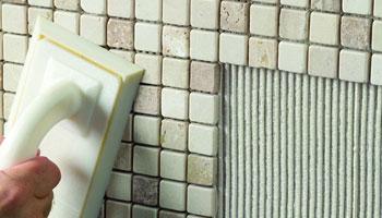 Laying Tiles on walls using adhesives