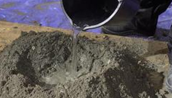 Adding water to the cement, sand and gravel mix