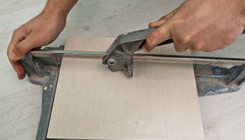 Cutting tiles in required shape and size